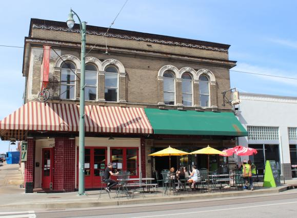 Historic Green Beetle bar building with red and green awning