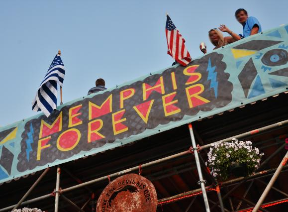 tent for bbq competition with a banner saying MEMPHIS FOREVER